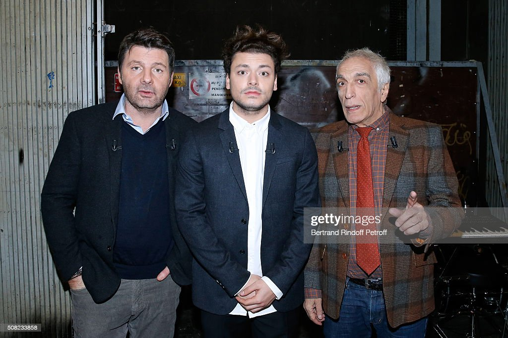 Main Guest of the Show, Actor and Humorist Kev Adams standing between Actors Philippe Lellouche (L) and Gerard Darmon (R) attend the 'Vivement Dimanche' French TV Show at Pavillon Gabriel on February 3, 2016 in Paris, France.