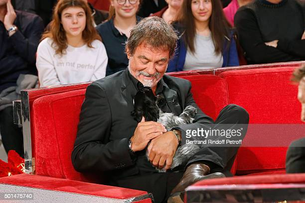 Main Guest of the Show actor Olivier Marchal and a little dog attend the 'Vivement Dimanche' French TV Show at Pavillon Gabriel on December 15 2015...