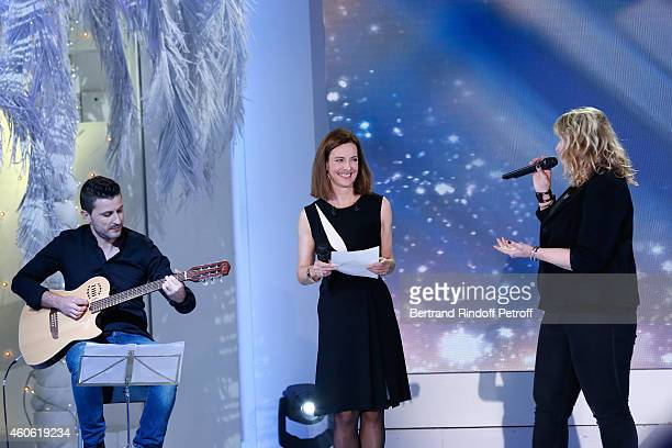 Main guest of the show actress Carole Bouquet and singer from 'The Voice' Veronick Severe perform during the 'Vivement Dimanche' French TV Show at...