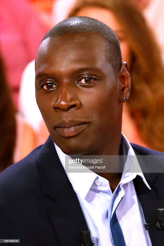 Main guest of the show and actor <a gi-track='captionPersonalityLinkClicked' href=/galleries/search?phrase=Omar+Sy&family=editorial&specificpeople=4110364 ng-click='$event.stopPropagation()'>Omar Sy</a> presents the movie 'Samba' during the 'Vivement Dimanche' show at Pavillon Gabriel on October 1, 2014 in Paris, France.
