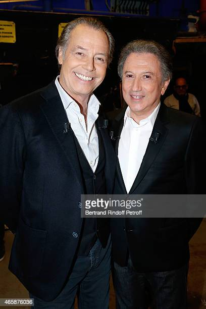 Main guest of the show humorist and actor Michel Leeb who presents the Theater Piece 'Le tombeur' and presenter of the show Michel Drucker attend the...
