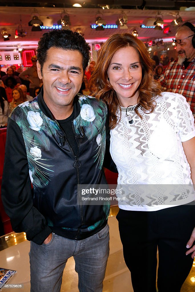 Main guest of the show Humorist Jamel Debbouze (L) presents with his wife and actress of the movie Melissa Theuriau, the movie 'Pourquoi j'ai pas mange mon pere ?', wich he directed and played in, during the 'Vivement Dimanche' French TV Show at Pavillon Gabriel on March 25, 2015 in Paris, France.