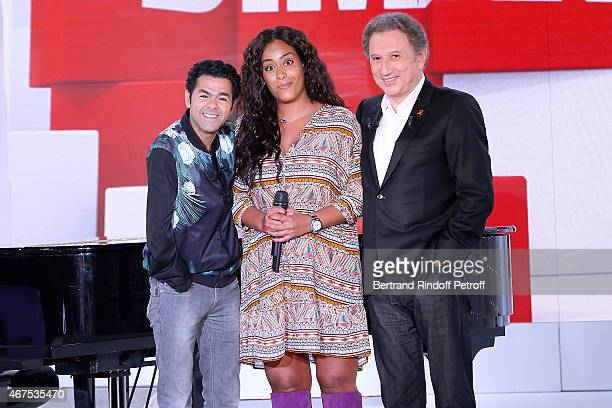 Main guest of the show Humorist Jamel Debbouze Singer Amel Bent and presenter of the show Michel Drucker attend the 'Vivement Dimanche' French TV...