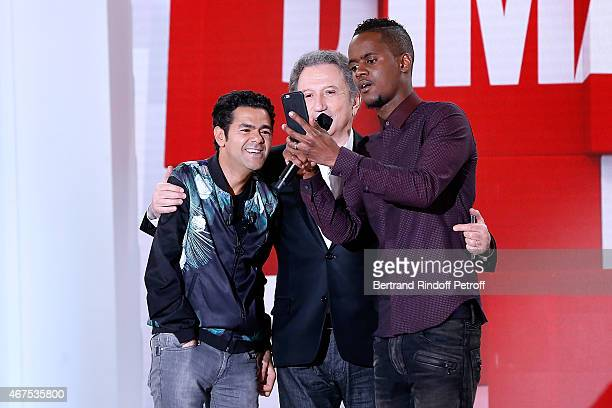 Main guest of the show Humorist Jamel Debbouze Singer Black M who takes a selfie and presenter of the show Michel Drucker attend the 'Vivement...