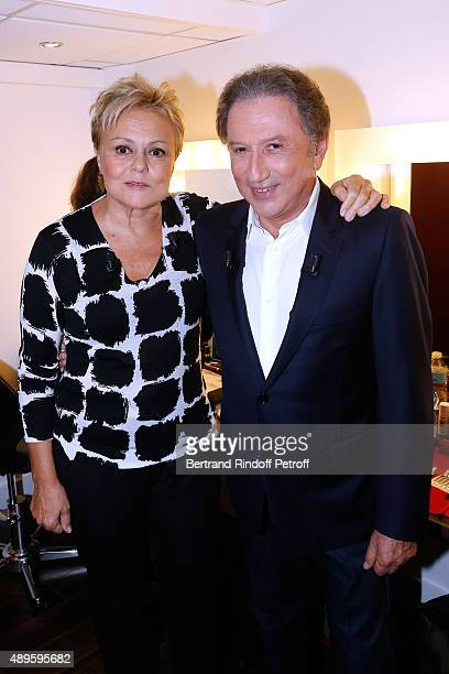 Main Guest of the Show Humorist Muriel Robin and Presenter of the show Michel Drucker attend the 'Vivement Dimanche' French TV Show at Pavillon...