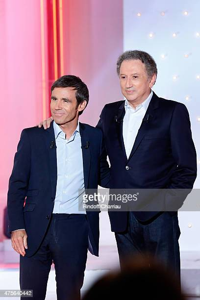 Main Guest of the show Journalist David Pujadas and Presenter of the show Michel Drucker attend the 'Vivement Dimanche' French TV Show at Pavillon...