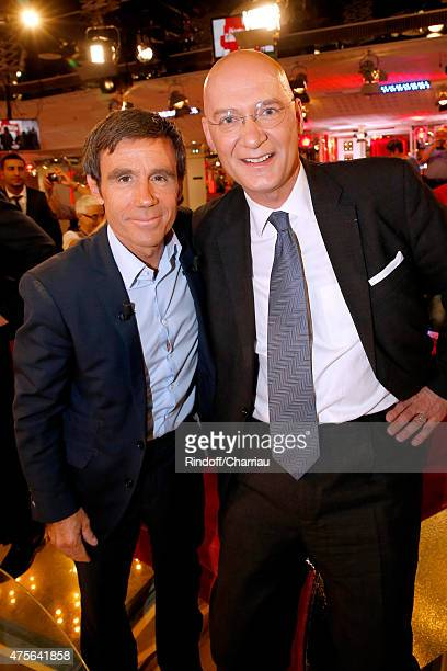 Main Guest of the show Journalist David Pujadas poses with Bruno Dellinger who presents his book 'World Trade Center 47th floor' during the 'Vivement...