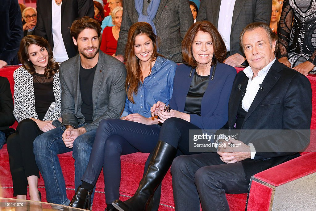 Main guest of the show Michel Leeb (R) with (L-R) his children Elsa Leeb, Tom Leeb, Fanny Leeb and his wife Beatrice Leeb attend the 'Vivement Dimanche' French TV Show at Pavillon Gabriel on January 7, 2015 in Paris, France.