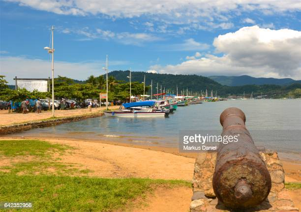 Main pier and rusted cannon in the town of Paraty, Rio de Janeiro