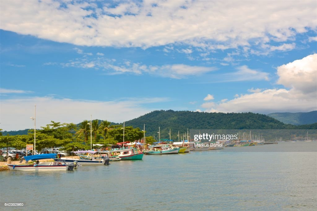 Main pier and tourist boats in the town of Paraty, Rio de Janeiro : Stock Photo