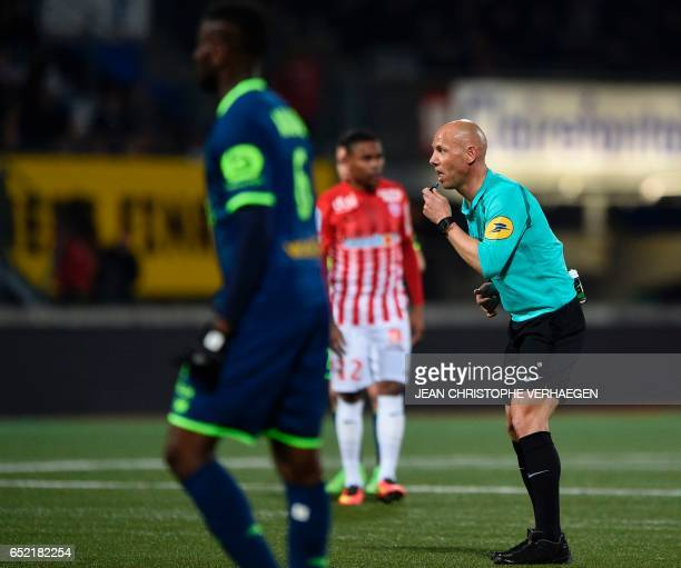 Main referee Amaury Delerue blows his whistle during the French L1 football match between Nancy and Lille at Marcel Picot Stadium in Tomblaine on...