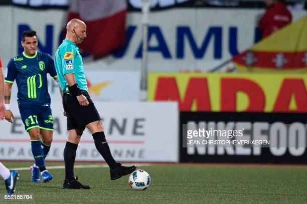 Main referee Amaury Delerue looks on during the French L1 football match between MHSC Montpellier and Nantes at La Mosson Stadium in Montpellier on...