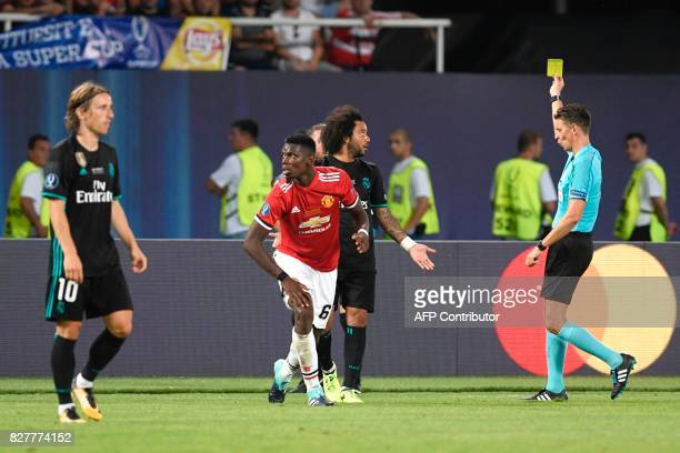 Main referee Gianluca Rocchi shows a yellow card during the UEFA Super Cup football match between Real Madrid and Manchester United on August 8 at...