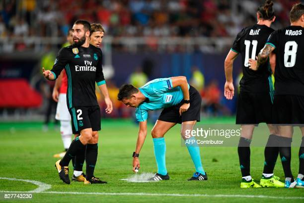 Main referee Gianluca Rocchi sprays a mark during the UEFA Super Cup football match between Real Madrid and Manchester United on August 8 at the...