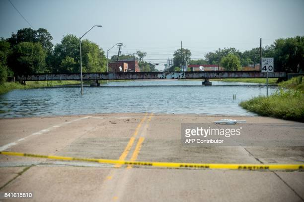 A main road is seen flooded in Port Arthur Texas September 1 2017 Houston was limping back to life on Friday one week after Hurricane Harvey slammed...