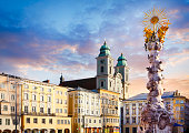 Main square in Linz with Old Cathedral (Alter Dom) and the Holy Trinity column