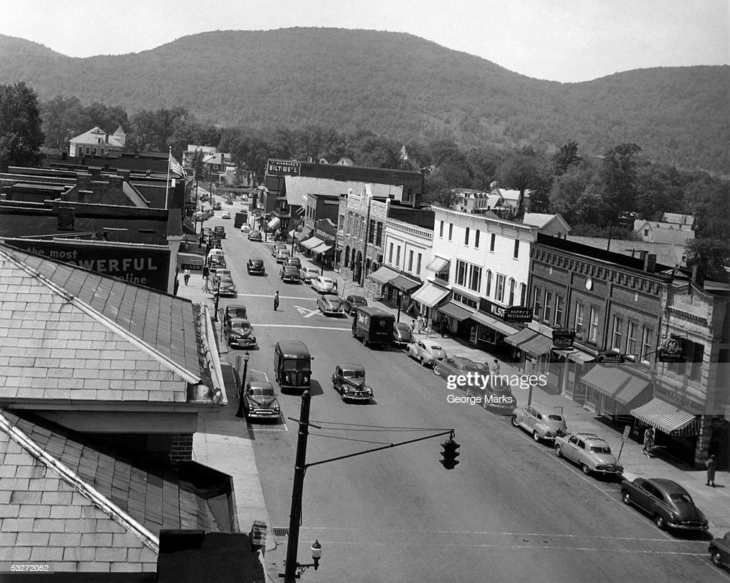 Main street with view of storefronts : Stock Photo