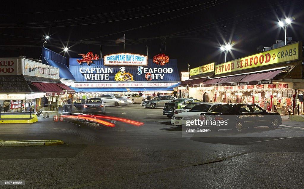 Maine Avenue Fish market illuminated at night : Stock Photo