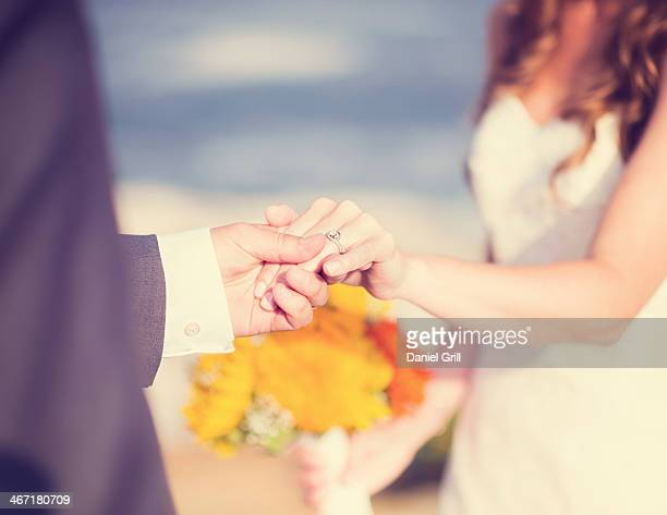 USA, Maine, Bristol, Close up of bride and groom holding hands