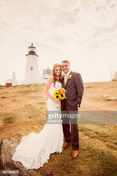 USA, Maine, Bristol, Portrait of married couple, lighthouse in background