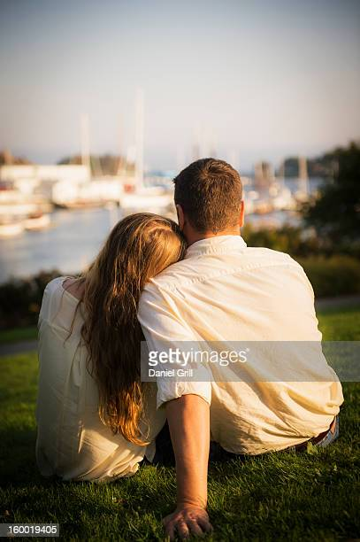 USA, Maine, Camden, Back view of couple looking at harbor