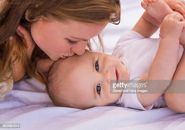 USA, Maine, Camden, Mother kissing baby (6-11 months)