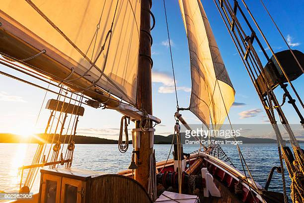 USA, Maine, Camden, Sailboat against sunset sky