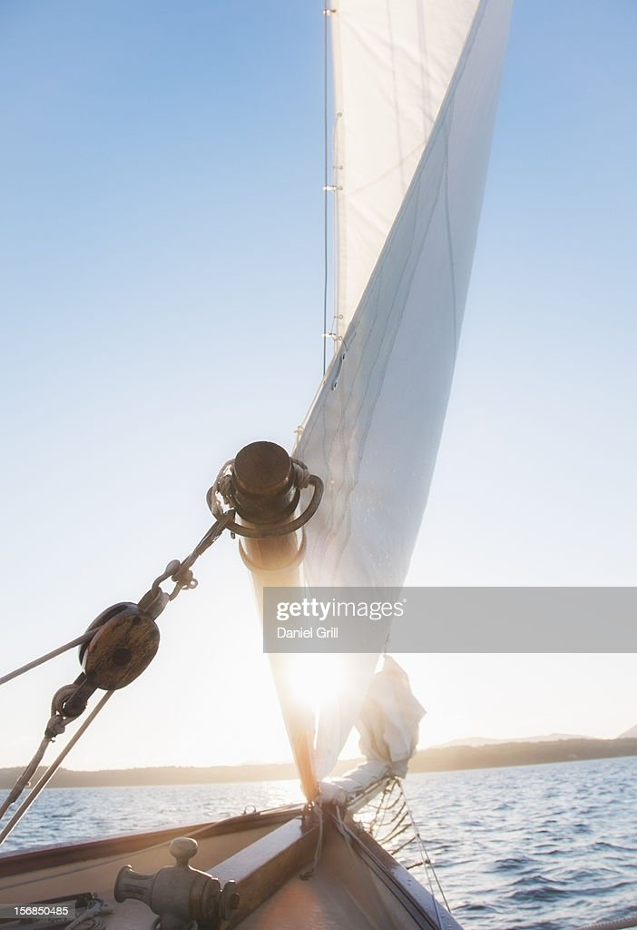 USA, Maine, Camden, View of sea with yacht bow and sail in foreground