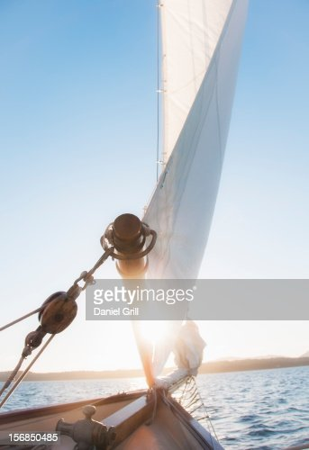 USA, Maine, Camden, View of sea with yacht bow and sail in foreground : Stock Photo