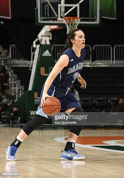 Maine guard Naira Caceres dribbles during an NCAA basketball game between the University of Maine Black Bears and the University of Miami Hurricanes...