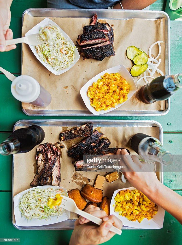 USA, Maine, Portland, Friends eating barbecue food