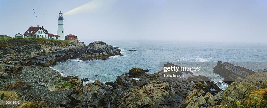 USA, Maine, Portland, Remote coastline with lighthouse