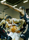 Maine Red Claws Rodney McGruder pushes through Erie Joe Crawford during first half action vs Erie Bayhawks Sunday February 22 2015 at the Portland...