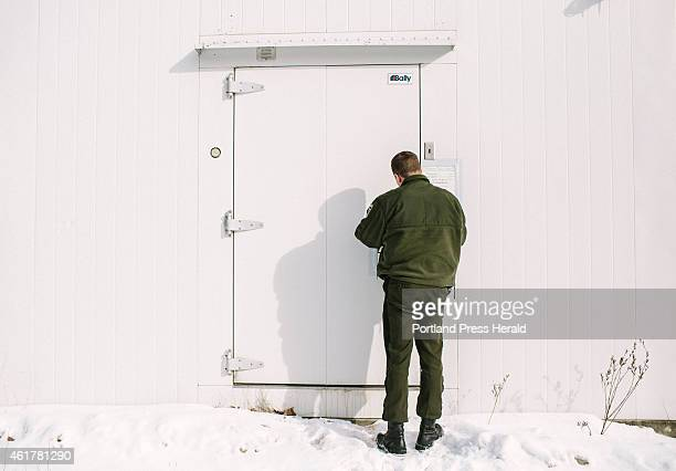 Maine Warden Service Corporal John MacDonald opens the freezer where evidence is stored from illegally gathered or poached animals in Gray ME on...