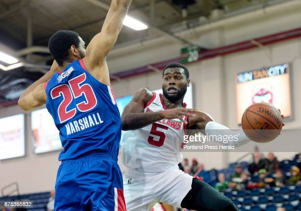 Maine's Kadeem Allen passes the bal asl Zeke Marshall of the Grand Rapids Drive moves in on defense Thursday November 16 2017