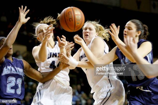Maine's Tanesha Sutton UNH's Olivia Healy and Kat Fogerty and Maine's Laia Sole all battle for a rebound in the first half of the women's semifinal...