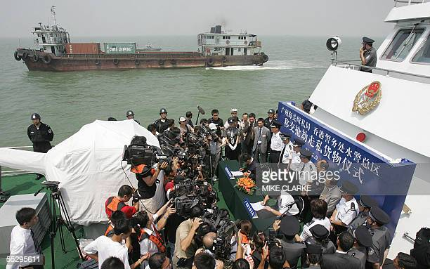 Mainland and Hong Kong media take pictures during a handover ceremony between senior customs officials from both sides of the border in front of a...