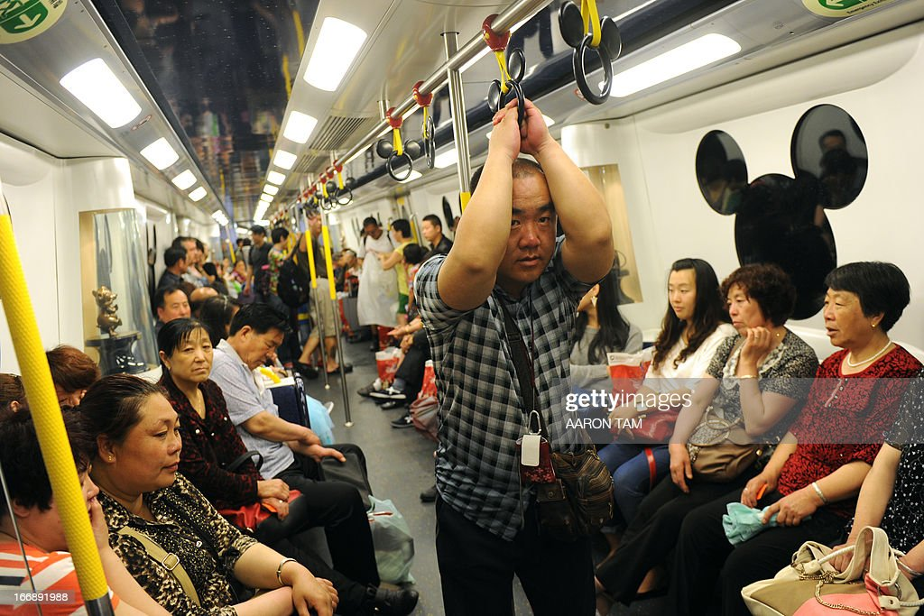 Mainland Chinese tourists ride on a uniquely designed subway train servicing Hong Kong's Disneyland on April 18, 2013. Hong Kong's once struggling Disneyland in February said it made a profit in 2012 for the first time since opening eight years ago, thanks to a surge in revenue as it welcomed a record number of visitors.
