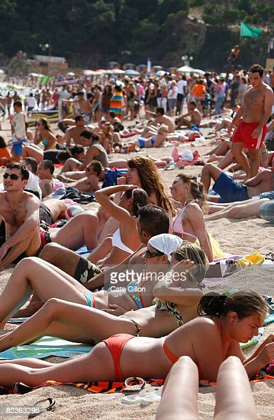 Mainly Italian and French tourists Holidaymakers visit the Platja de Lloret on August 14 2008 in Lloret de Mar Spain British visitors are few and far...