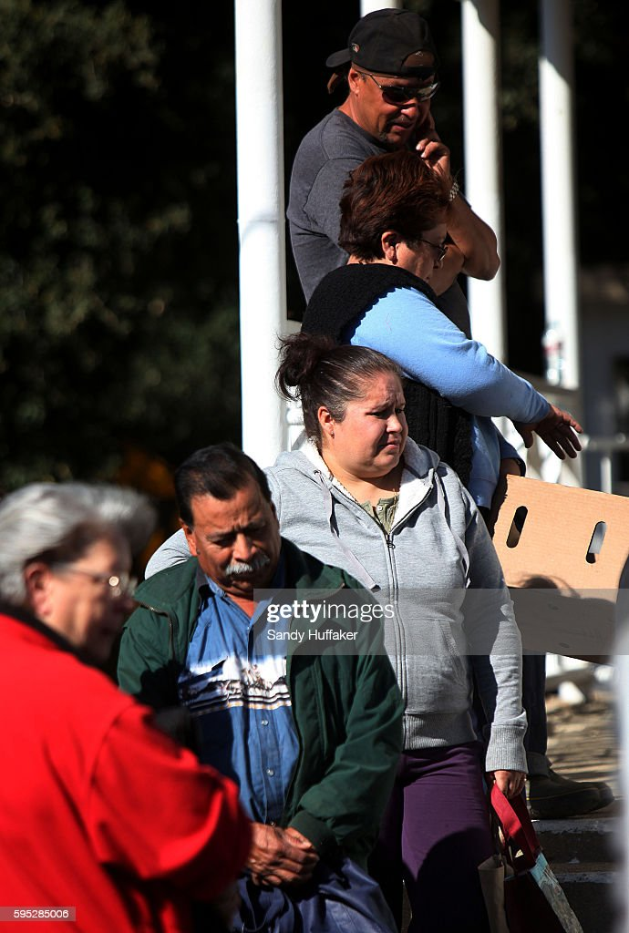 Mainly poor and elderly residents wait in line early to receive donated food items from a Feeding America truck on Thursday November 3 2011 in...