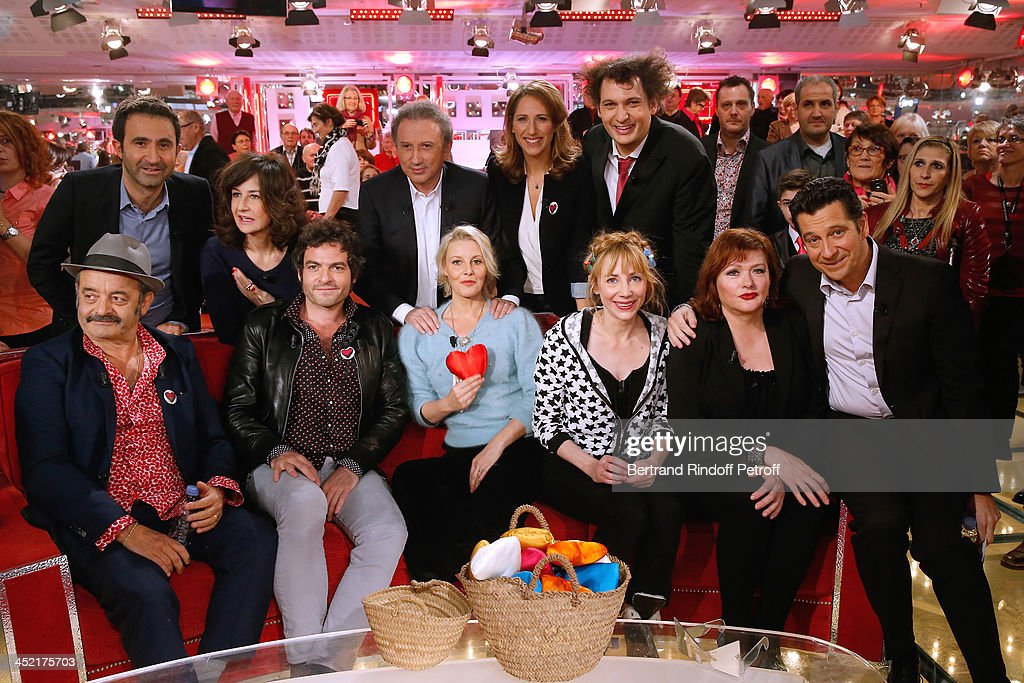 Mains guests of the show Louis Chedid and his son Mathieu Chedid 'M', Florence Thomassin, Julie Depardieu, Catherine Jacob and Laurent Gerra, (back row L-R) Mathieu Madenian, Valerie Lemercier, Michel Drucker, Maud Fontenoy and Eric Antoine attend 'Vivement Dimanche' French TV Show at Pavillon Gabriel on November 26, 2013 in Paris, France.