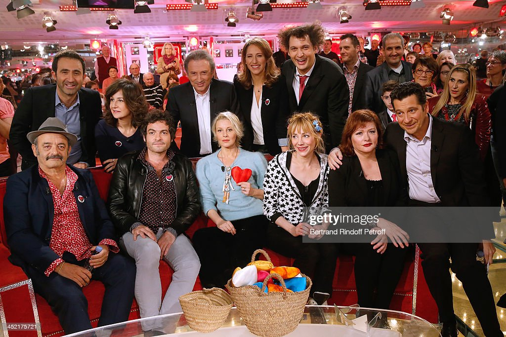 Mains guests of the show Louis Chedid and his son <a gi-track='captionPersonalityLinkClicked' href=/galleries/search?phrase=Mathieu+Chedid&family=editorial&specificpeople=624503 ng-click='$event.stopPropagation()'>Mathieu Chedid</a> 'M', Florence Thomassin, <a gi-track='captionPersonalityLinkClicked' href=/galleries/search?phrase=Julie+Depardieu&family=editorial&specificpeople=2247151 ng-click='$event.stopPropagation()'>Julie Depardieu</a>, <a gi-track='captionPersonalityLinkClicked' href=/galleries/search?phrase=Catherine+Jacob&family=editorial&specificpeople=617794 ng-click='$event.stopPropagation()'>Catherine Jacob</a> and <a gi-track='captionPersonalityLinkClicked' href=/galleries/search?phrase=Laurent+Gerra&family=editorial&specificpeople=538435 ng-click='$event.stopPropagation()'>Laurent Gerra</a>, (back row L-R) Mathieu Madenian, <a gi-track='captionPersonalityLinkClicked' href=/galleries/search?phrase=Valerie+Lemercier&family=editorial&specificpeople=833898 ng-click='$event.stopPropagation()'>Valerie Lemercier</a>, <a gi-track='captionPersonalityLinkClicked' href=/galleries/search?phrase=Michel+Drucker&family=editorial&specificpeople=769504 ng-click='$event.stopPropagation()'>Michel Drucker</a>, <a gi-track='captionPersonalityLinkClicked' href=/galleries/search?phrase=Maud+Fontenoy&family=editorial&specificpeople=686588 ng-click='$event.stopPropagation()'>Maud Fontenoy</a> and Eric Antoine attend 'Vivement Dimanche' French TV Show at Pavillon Gabriel on November 26, 2013 in Paris, France.