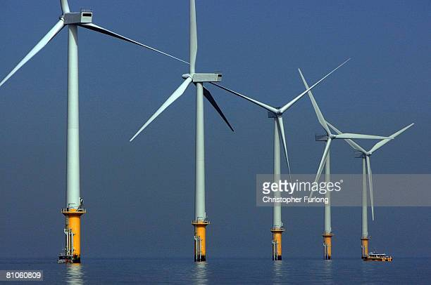 A maintenance boat works next to the turbines of the new Burbo Bank off shore wind farm in the mouth of the River Mersey on May 12 2008 in Liverpool...