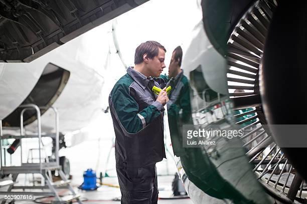 Maintenance engineer examining airplane