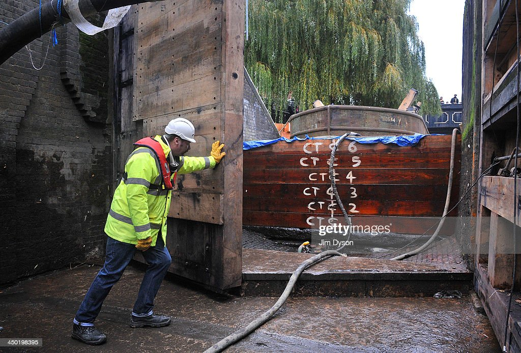 Maintenance manager Sam Thomas closes one of the newly fitted lock gates at Hampstead Road Lock in Camden on November 17, 2013 in London, England. As part of a £130,000 refurbishment programme the Canal and River Trust have invited the public entry into the lock chamber.