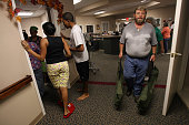 Maintenance supervisor Jim Hunt brings in cots and family members linger in the hallway as Hurricane Ike nears at nursing home Ashton Parke Care...