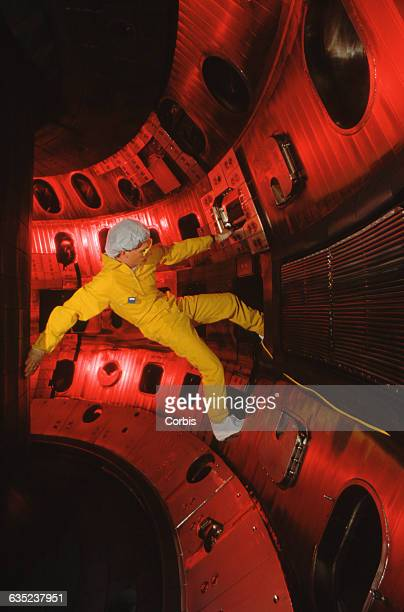 A maintenance worker inside the vacuum chamber of the Tokamak Fusion Test Reactor