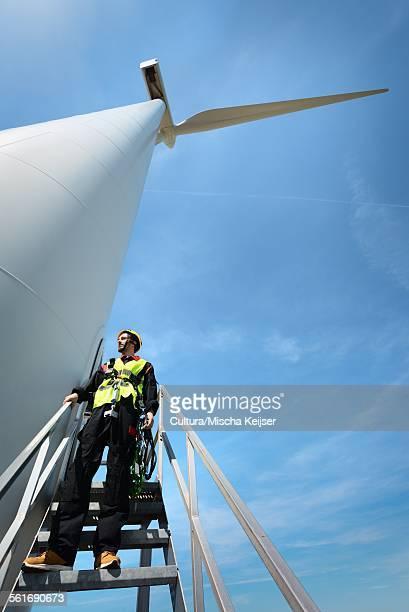 Maintenance worker standing on a modern wind turbine, Biddinghuizen, Flevoland, Netherlands