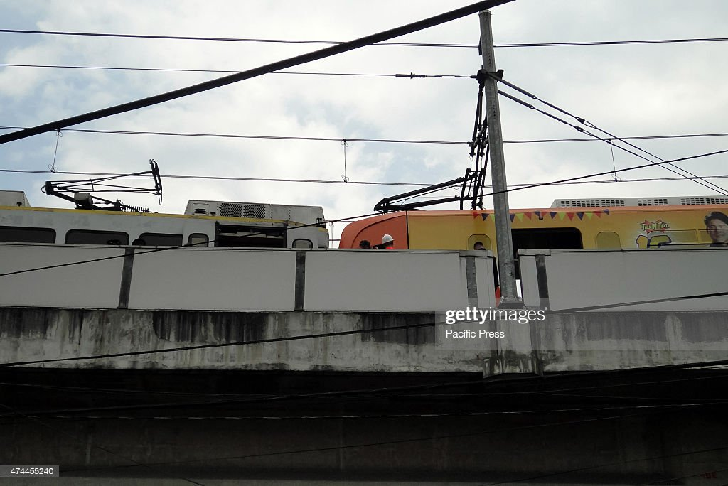 Maintenance workers inspect the damaged trains center along Monumento Railway operations along the Light Rail TransitLine 1 were temporarily affected...