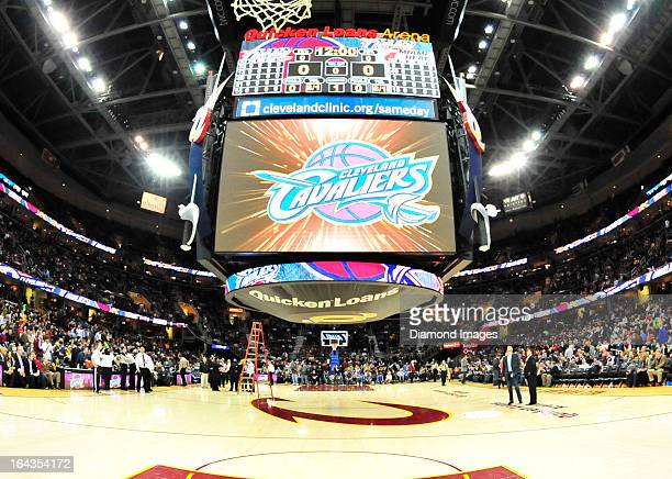 Maintenance workers work on fixing a scoreboard malfunction that delayed the start of a game between the Cleveland Cavaliers and Miami Heat at...
